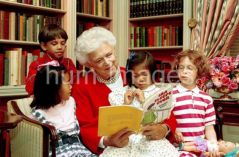 Mrs. Barbara Bush reads to children in the White House Library, .24 Jul 90. (July 24, 1990).