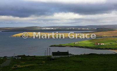 Looking over Gluss Isle across Sullam Voe to the Sullam Voe oil Terminal from Hill of Ollaberry, Northmavine, Shetland