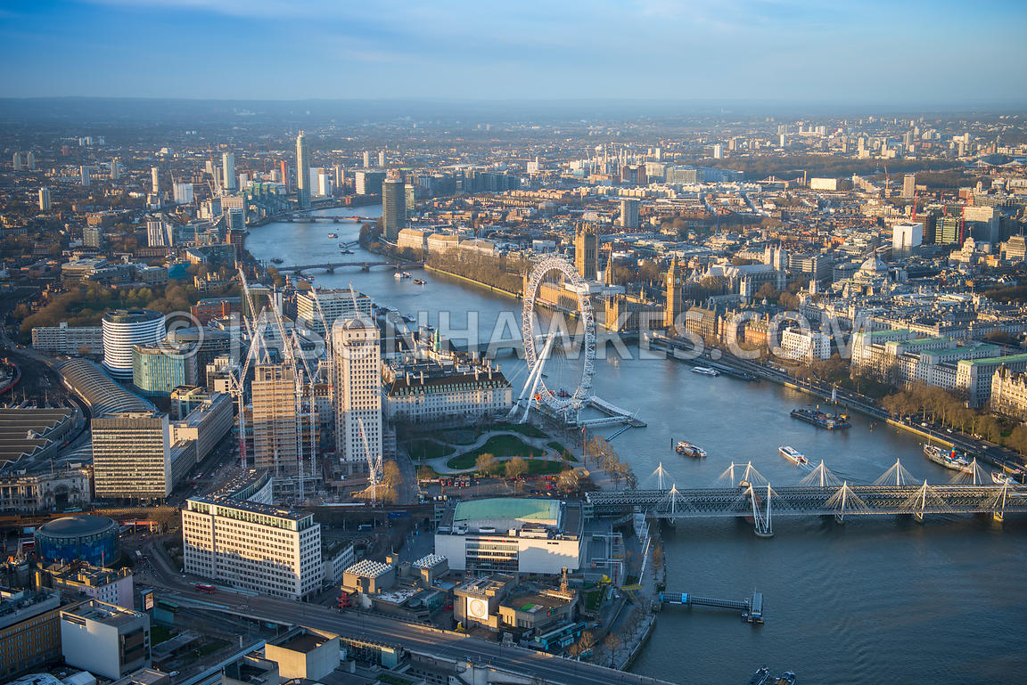 Aerial view of London Eye with Golden Jubilee Bridges and Royal Festival Hall.