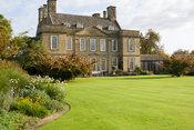 Bourton House, dating from the early eighteenth century, set off by a pair of Parrotia persica and a broad sweep of lawn. Bou...