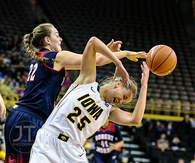 Robert Morris' Megan Smith (22) and Iowa's Kali Peschel (25)battle for the ball during the first half of play at Carver-Hawke...