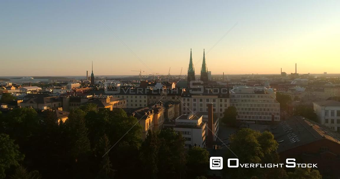 Helsinki Cityscape, Aerial Rising View of Punavuori and Saint Johns Church, in the City of Helsinki, on a Sunny Summer Evenin...