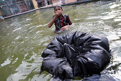 A boy swims in a filthy fountain in Newmarket, Kolkata, India. I never saw my umbrella again!