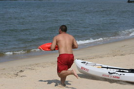 cool_image_of_lifeguard_running_rescue_kayak