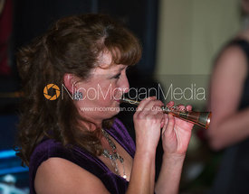 Woman blowing a hunting horn