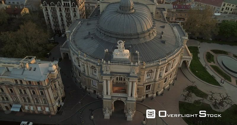 Aerial camera slowly spins around the front of Odessa Opera Theatre at sunrise Ukraine