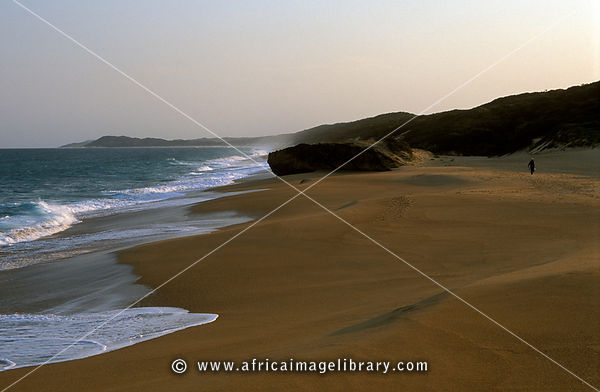 Fisherman walking along the beach at Rocktail Bay, Maputaland, Kwazulu-Natal, South Africa