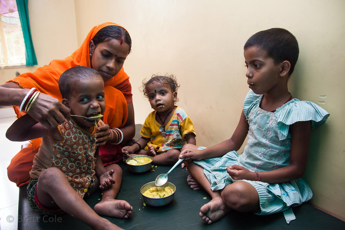 Children receive supplemental meals at the Swastha Kendra clinic operated by the NGO Calcutta Kids (calcuttakids.org) in the ...