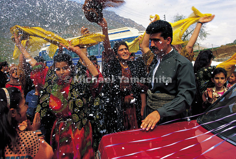 A wedding in Jundian: flakes of shaving foam rain down on the newly weds.