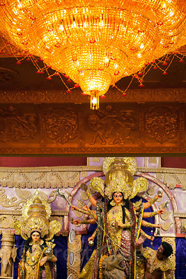 A large golden chandelier in a pandal (temporary temple of sorts) during the Durga Puja festival, Gariahat, Kolkata, India. A...