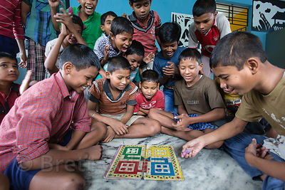 Children play Pachisi, or Cross and Circles, a traditional Indian board game that is the basis for the well-known board game ...
