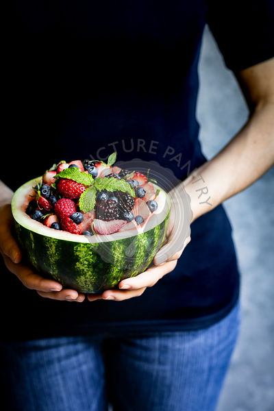 Watermelon fruit bowl held in a womans hands