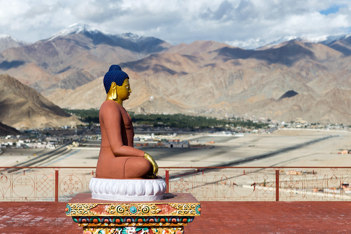 Buddha statue overlooking the city of Leh, at the Spituk Gompa monastery, Leh, Ladakh, India