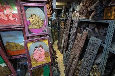 Religious paintings and carvings in a shop at Chor Bazaar, also known as the Thieves Market, Mumbai, India.