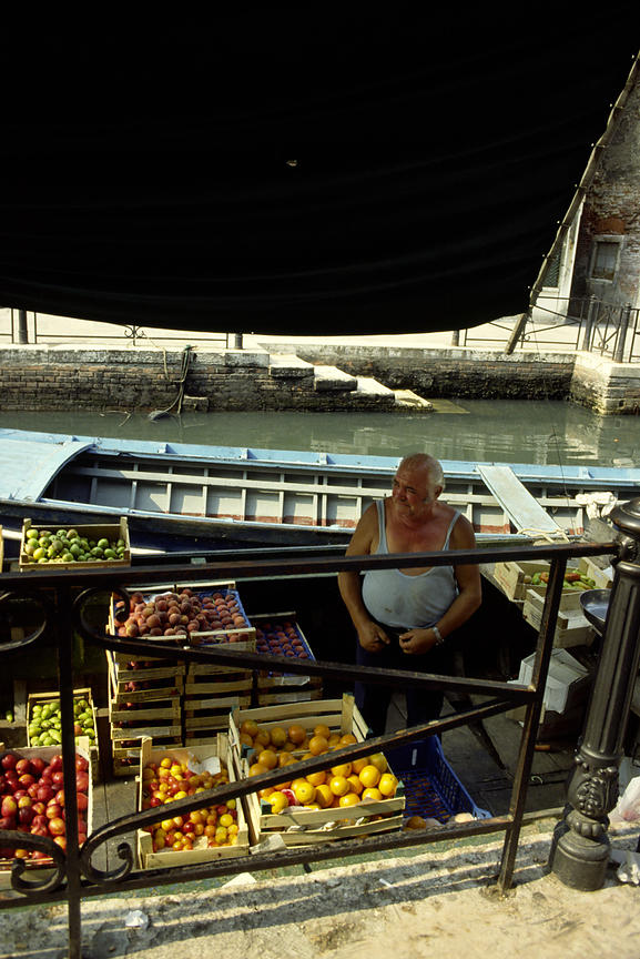 Italy - Venice - A vegetable seller on his boat in a canal