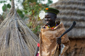 Karamojong man with a traditional horn in the village, northern Uganda
