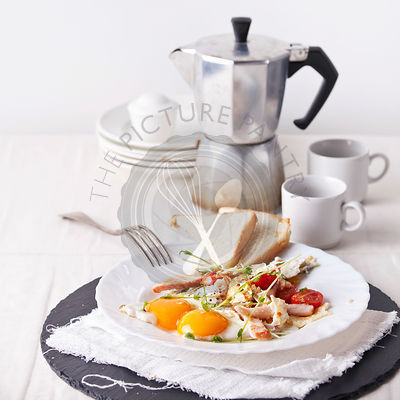 Ham and egg breakfast with toast, coffee and salad