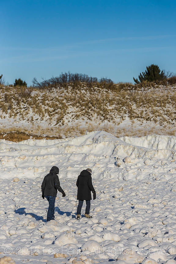 People Crossing Field of Ice Balls Created During Winter Storms in Rosy Mound Natural Area along Lake Michigan