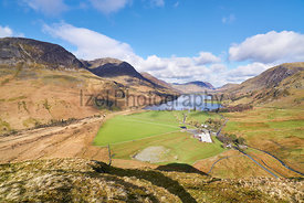 Views of Lake Buttermere and mountain summits of High Crag, High Stile and Red Pike with Gatesgarth Farm in the valley.  Flee...