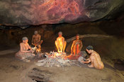 Replica of San people sitting in a cave,  Cango Caves, Oudtshoorn, South Africa