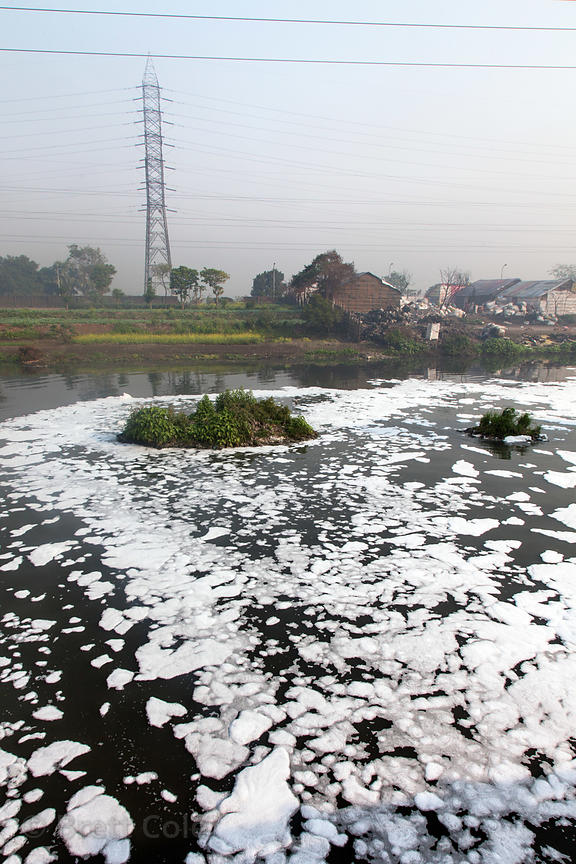 Foamy, dirty water in an unnamed creek near Bantala and Dhapa, Kolkata, India. The area is home to the main landfill for Kolk...