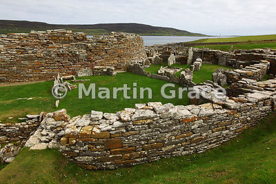 The Broch of Gurness, an Iron-Age stone defensive tower, with part of its surrounding village, West Mainland, Orkney