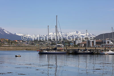 Sailing boats at berth in Ushuaia, with mountains of Tierra del Fuego behind, Argentina