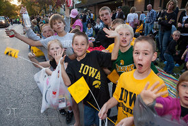 Parade spectators wave  during the  University of Iowa homecoming Parade in Iowa City on Friday September 28, 2012. (Justin T...