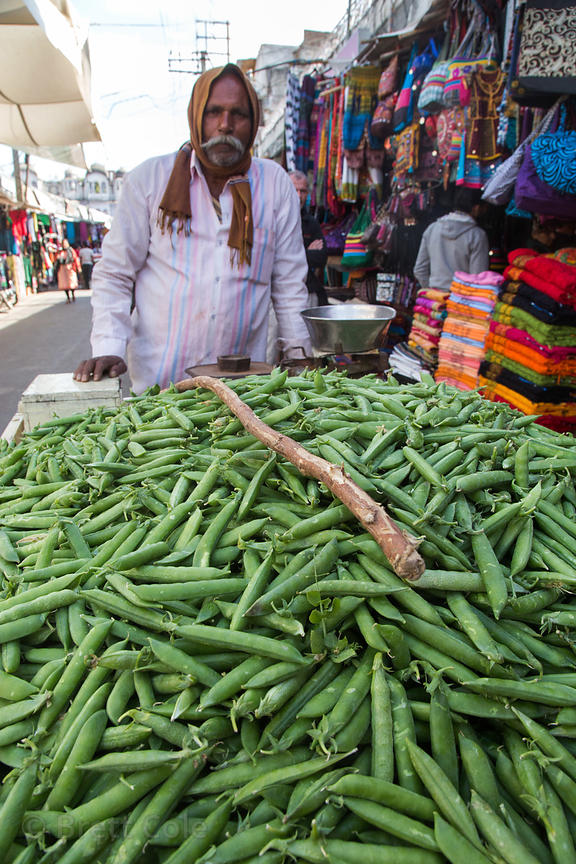 A man sells mutter (peas) in Pushkar, Rajasthan, India