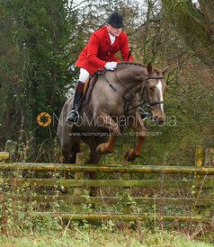 Michael Dungworth jumping a hunt jump in Holwell. The Belvoir Hunt at Hill Top Farm 1/12