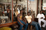 men sitting outside the Pan African Market, Long Street, Cape Town, South Africa