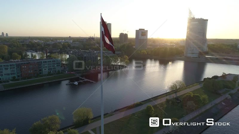 Aerial drone shot of a large flag of Latvia during sunset in Riga, capital of Latvia.