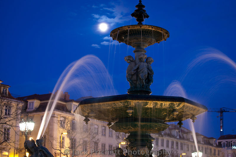 Lisbon's Praza Rossio at night with full moon