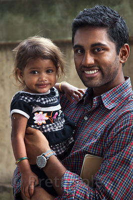 An NGO worker meets with a toddler who was treated for malnutrition, in the Fakir Bagan area of Howrah, India.