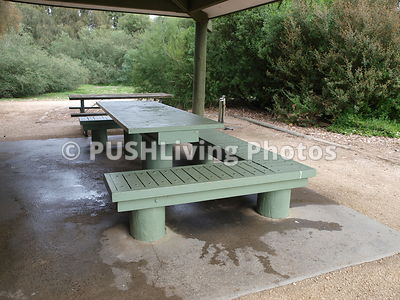 Open sided table with large concrete hard surface