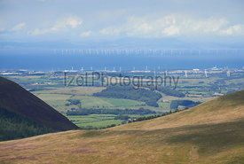 Robin Rigg Wind Farm on the Solway Firth from the summit of Great Borne in the English Lake District, UK.