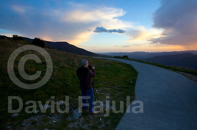 Photographer taking pictures at Sunset (Coll de Jou)