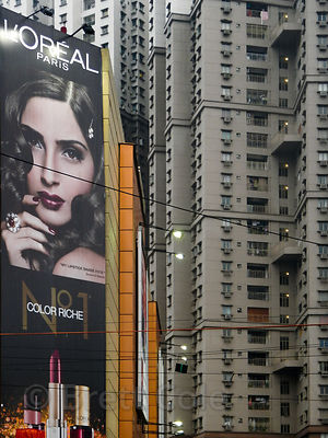 Loreal makeup ad next to South City Mall, Kolkata, India. On the right are three 35-story apartment buildings, the tallest bu...