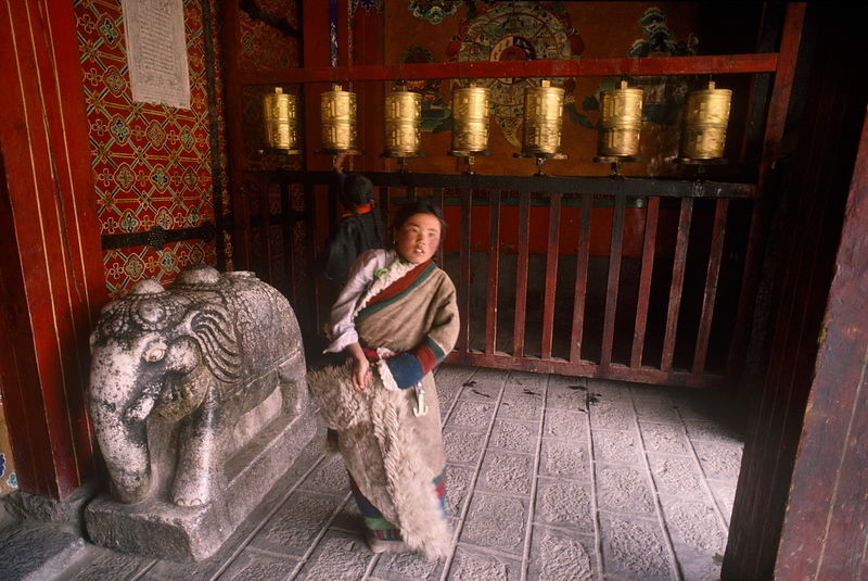 Pilgrims at entrance, Utse, Samye Monastery. Built in the 8th century, Samye Monastery was the first Buddhist monastery to be...