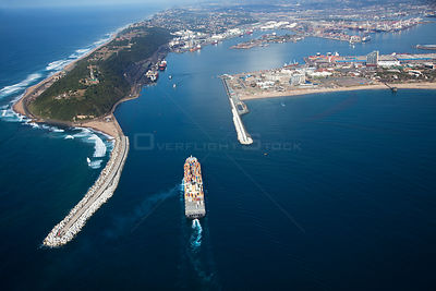 Aerial photograph of Durban Harbour breakwater with freighter boat entering the harbour, KwaZulu-Natal Province,South Africa,...
