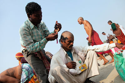 A man gets his head shaved as part of a Hindu ritual at the Gangasagar Mela, Sagar Island, India.
