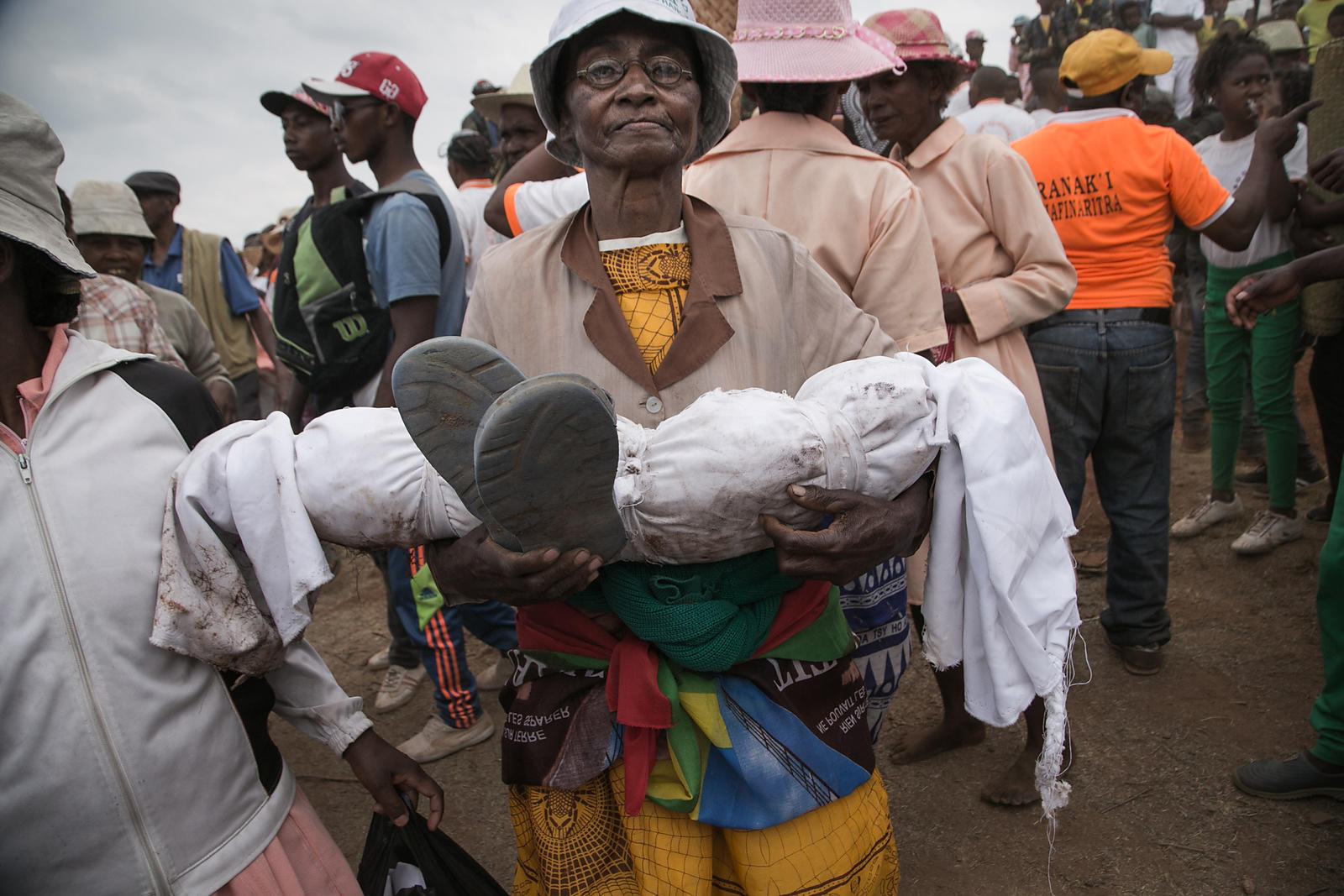 Isabel Malala Razafindrakoto carries the wrapped body of her son, who died aged just three years old, as she takes part in a ...