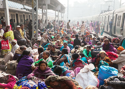 Pilgrims crowd the Sealdah Railway Station platform to travel to Sagar Island, India for the Gangasagar Mela, a Hindu pilgrim...