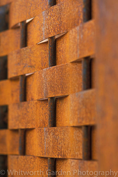 A lattice fence of corten steel. © Rob Whitworth