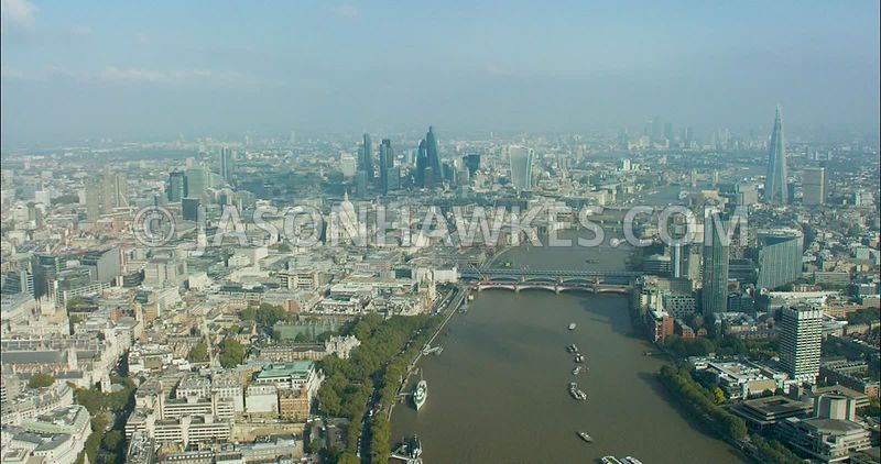 London Aerial Footage of River Thames at Blackfriars bridges towards City of London.