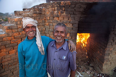 Workers at a facility that burns scrap leather, near Bantala, East Kolkata Wetlands, Kolkata, India.