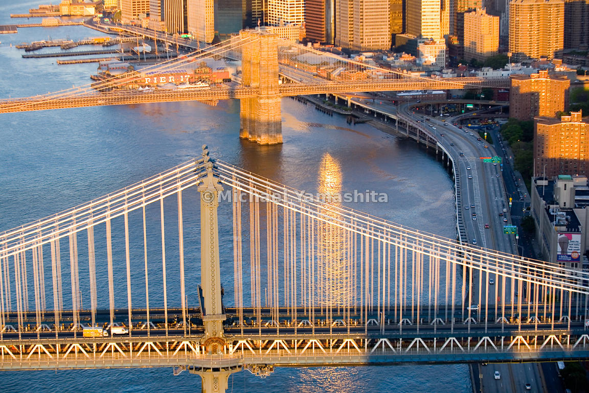 The Manhattan Bridge is one of two suspension bridges in New York that carry both vehicular and rail traffic; four subway tra...