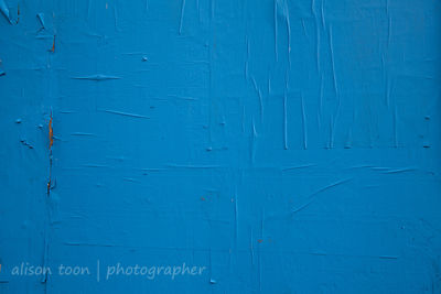 Blue paint and peeling paper