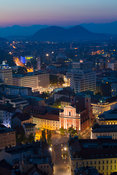 Sunset over Ljubljana. View from the castle with the Triple Bridge (Tromostovje) and the Franciscan Church of the Annunciatio...