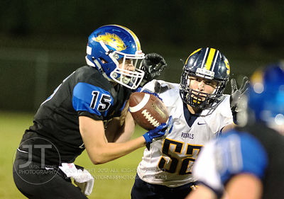 Wilton's Drake Hayes (15) hauls in a pass as Iowa City Regina's Nick Wagner (52) defends during the second half of play in Wi...